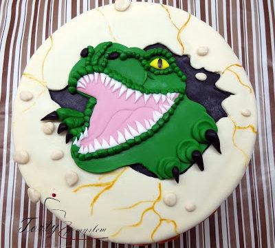 tort z wychodzącym tyranozaurem